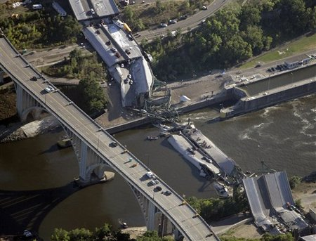 This is the scene of the collapsed 35W bridge over the Mississippi River Thursday, Aug. 2, 2007, in Minneapolis. (AP Photo/Morry Gash)