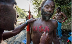 """Lamakara villagers paint USA on theirs chests and backs. For them the United States is a dream country, from where they except to receive """"cargo"""", that was promised by John Frum."""