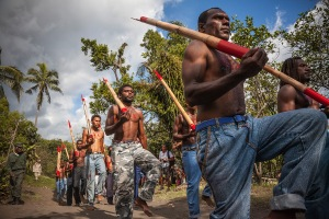 """Cargo cult members march with bamboo """"rifles"""" during the celebration of John Frum's Day in Lamakara village."""